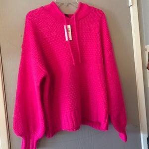 Bright pink AE Studio sweater